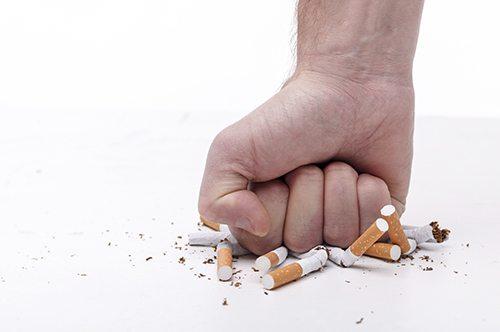 Fist crushing cigarets.