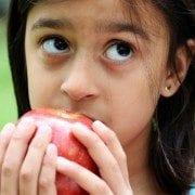Girls eating apples.